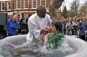 Kippa Matthews's photograph of the archbishop of York, Dr John Sentamu, conducting a baptism by total immersion outside the church of St Michael-le-Belfrey, York, 2006.