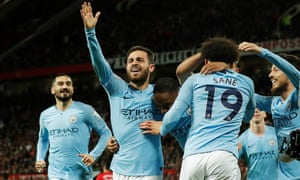 Manchester City players celebrate during their derby win over United.