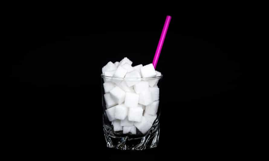 Glass filled up with sugar cubes