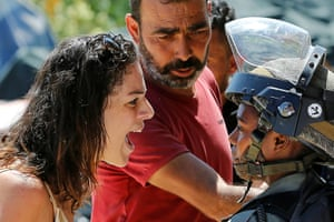 A Palestinian woman argues with an Israeli border guard in Beit Jala, West Bank