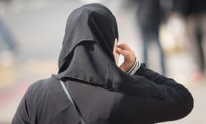A woman wearing a veil