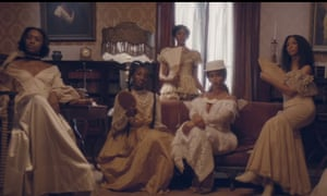 Beyoncé and a group of women in white, antebellum-inspired fashion in the video for her new single Formation.