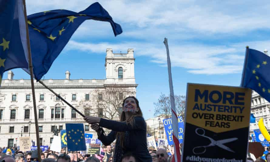 A young woman waves an EU flag at the Unite for Europe rally in Parliament Square on 25 March