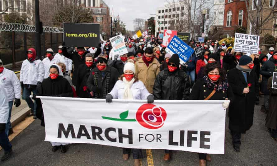 Anti-abortion activists participate in the annual March for Life in Washington DC on 29 January.