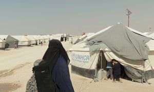a woman and children in Syria's al-Hawl refugee camp