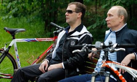 Medvedev and Vladimir Putin relax during a cycle ride in 2011