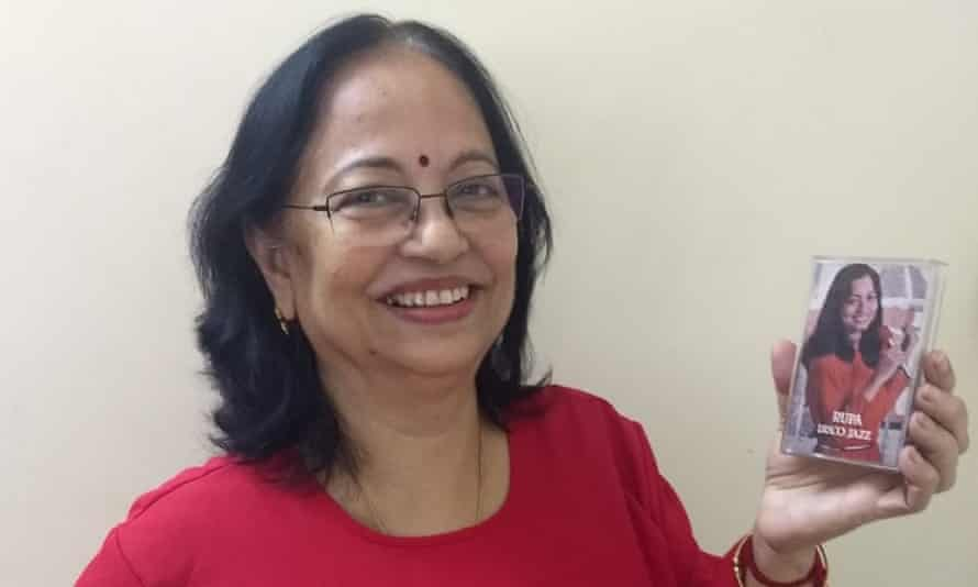 Rupa Biswas holding a cassette of the album she recorded in 1981.