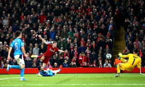 Alex Meret of Napoli saves a shot from James Milner of Liverpool.