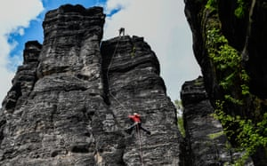 Saxony, GermanyRock climbers climb on a sandstone cliff in the Saxon Switzerland national park, Rosenthal-Bielatal area