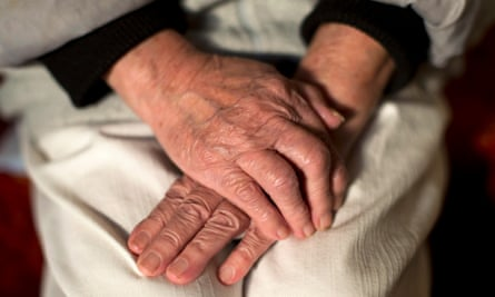 Photo showing the hands of an elderly woman.
