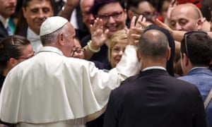 Pope Francis waves to members of the congregation during a conference for people with disabilities