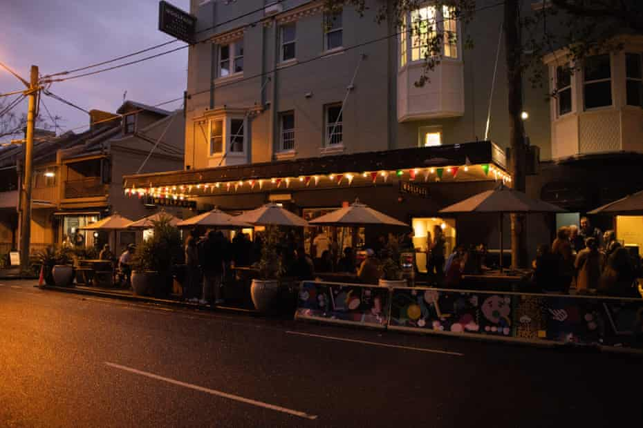 Patrons gather outside the Woolpack hotel in Redfern on Monday evening.
