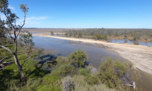 Wide shot of floodwaters banked up on Chris Lamey's property, Goondiwindi, QLD.