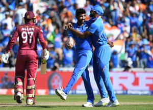 India's Jasprit Bumrah celebrates with captain Virat Kohli (right) the wicket of West Indies' Fabian Allen for a duck.
