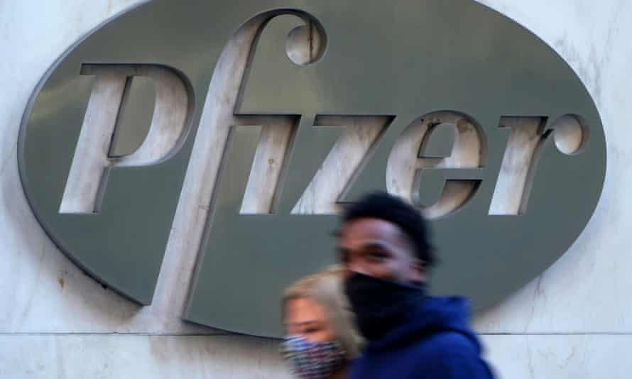 People walk past the Pfizer building in New York City, US.
