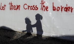 Shadows of children on a tent at the northern Greek border point of Idomeni.