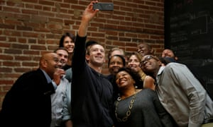 Facebook CEO Mark Zuckerberg poses for a selfie with a group of entrepreneurs