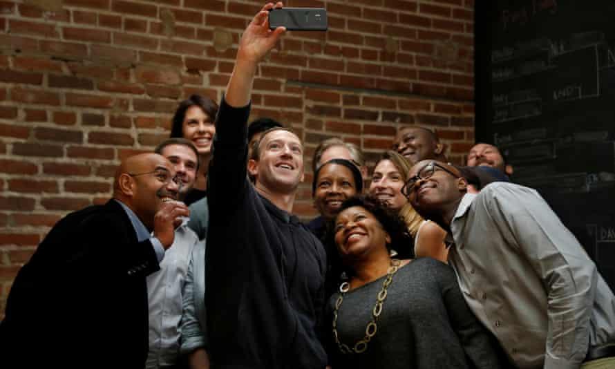 Facebook CEO Mark Zuckerberg poses for a selfie with a group of entrepreneurs