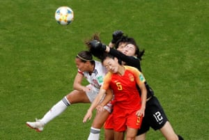 China's Shimeng Peng punches clear under pressure from Andrea Falcon.
