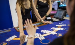Two female croupiers at a blackjack table