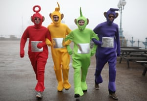 Four darts fans dressed as Teletubbies