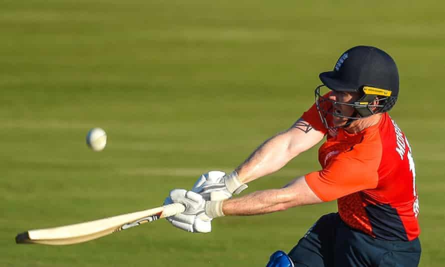 England's captain Eoin Morgan throws the bat during his barnstorming unbeaten 57 off 22 balls including seven sixes.