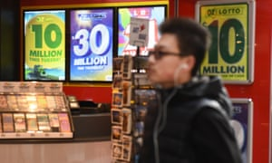 Man in front of lottery signs