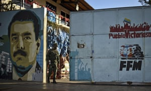 A mural depicts President Nicolás Maduro.