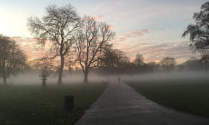 Cycling through Brockwell Park in south London at dawn on a misty morning.