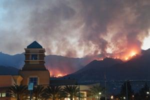 The La Tuna fire burns above downtown Burbank, California