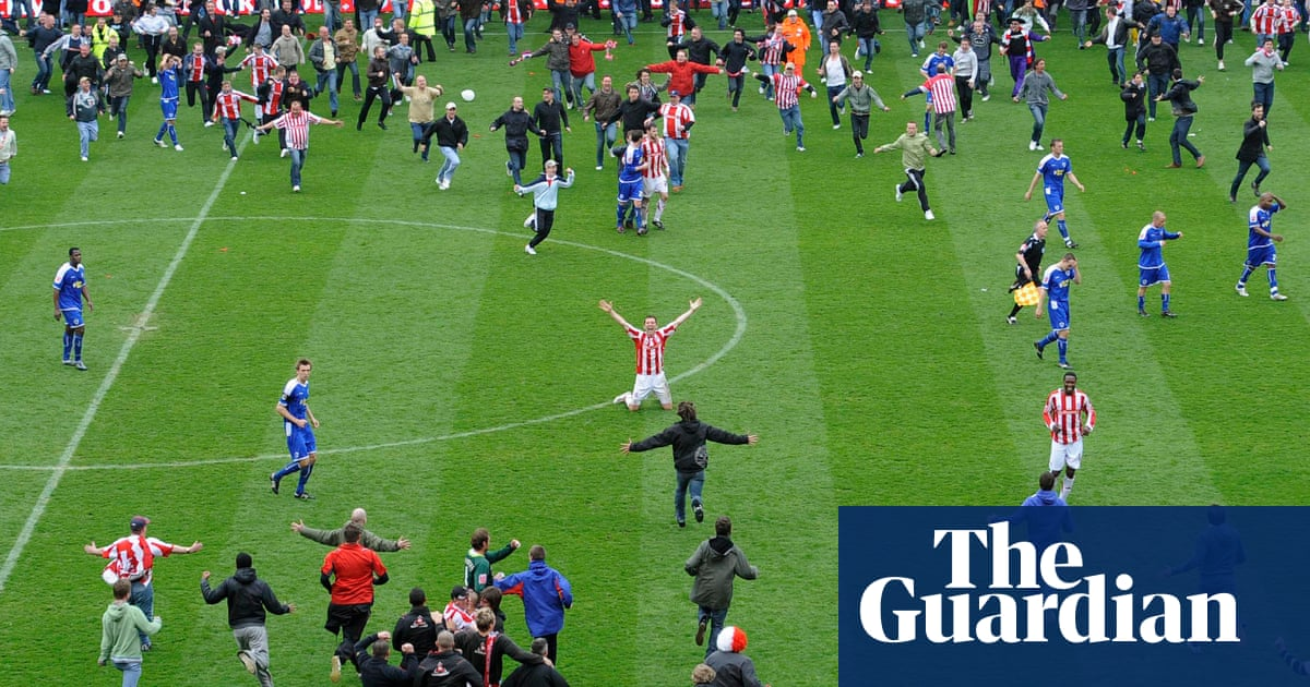 Being there: football fans in stadiums – buy a Guardian photograph