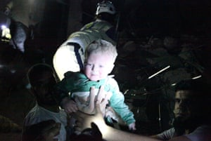 The Syrian civil defence rescue a baby from rubble after a regime airstrike