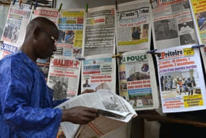 Newspapers on sale three days after the deadly attack at the Radisson Blu hotel in Bamako, Mali