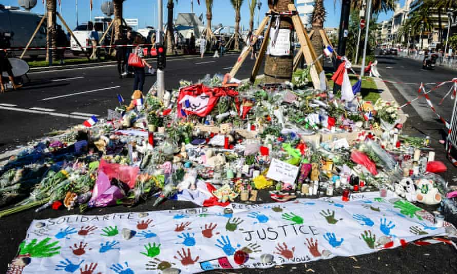 Flowers and written tributes are laid on the Promenade des Anglais.
