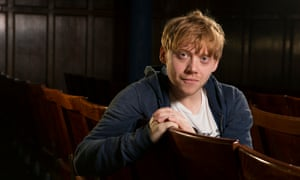 rupert grint sitting in the stalls at the harold pinter theatre london