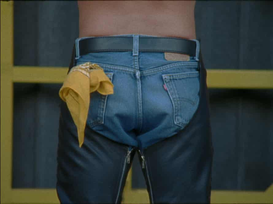Man with a yellow handkerchief in back pocket