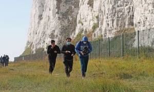 A group of people thought to be migrants arrive on the Kent coast.