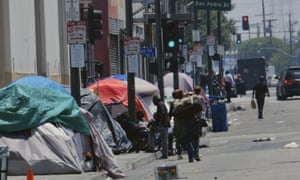 Tents along a street in downtown Los Angeles. The number of homeless people counted across the county has jumped 12% since last year.