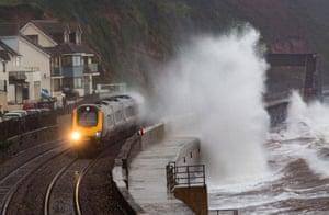 Waves crash into the Dawlish seafront in Devon