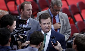 Paul Manafort is surrounded by reporters on the floor of the Republican National Convention in Cleveland. He was hired as campaign manager in part because of his experience at the 1976 Republican convention.