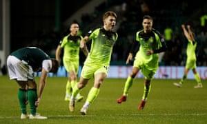 James Forrest celebrates scoring Celtic's first goal against Hibs.