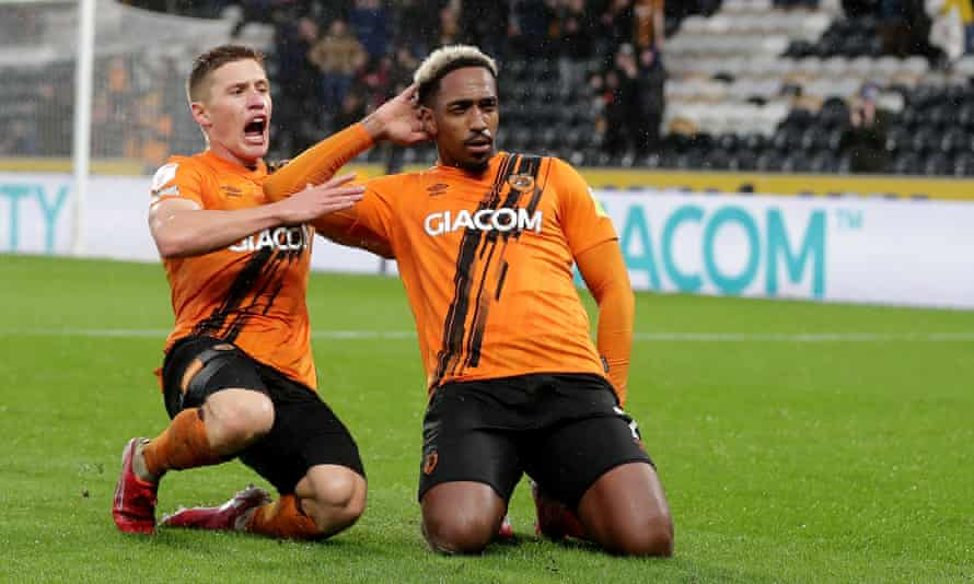 Mallik Wilks celebrates with teammate Greg Docherty after scoring Hull's second of the game.
