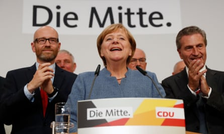 Angela Merkel addresses supporters after exit polls showed the chancellor's CDU party heading for a comfortable victory in the German elections.