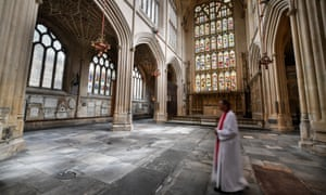 Canon Guy Bridgewater walks across the completed floor in the East Wing of Bath Abbey