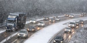 Tyne and Wear, England: Cars make their way through the snow