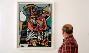 A man looks at the Picasso artwork Le Baiser