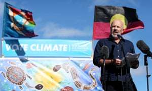 Australian author Richard Flanagan speaks during a Stop Adani rally outside Parliament House on Sunday to mark the last stop on the Tasmania to Canberra via Queensland Stop Adani convoy led by Bob Brown.