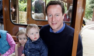 David Cameron in 2007 with his children, Elwen aged one (on his lap) and Nancy aged three.