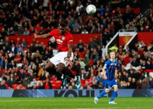 Manchester United's Paul Pogba heads over.