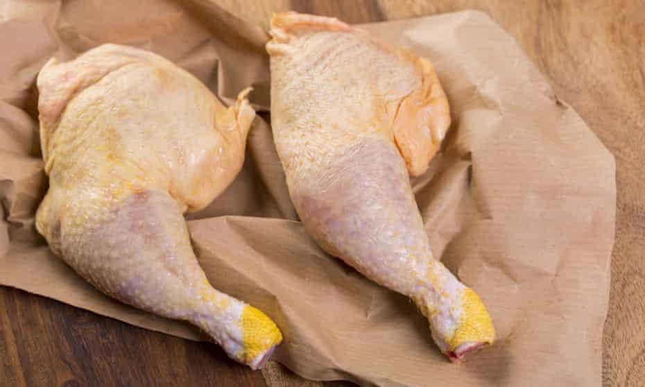 Two raw chicken legs.